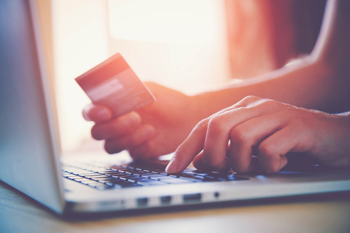 Online shopping with credit card and laptop
